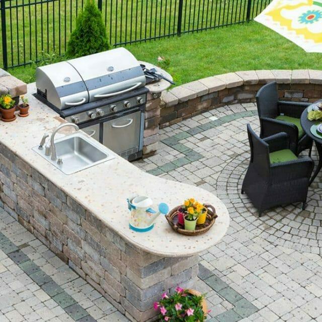 Backyard patio with stone kitchen